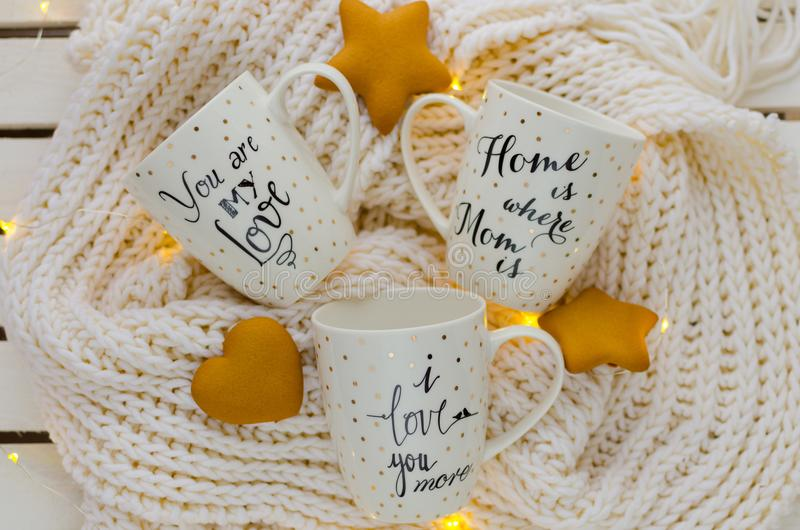 White porcelain cup. With inscription `Home is where Mom is`, `you are my love`. `i love you royalty free stock photos