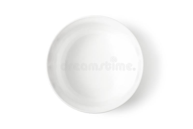 White porcelain dish. Deep white porcelain dish isolated on white. View from above stock image