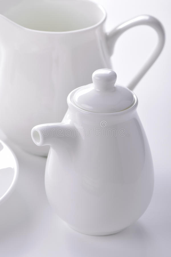 White porcelain sauceboat and creamer close-up stock photography