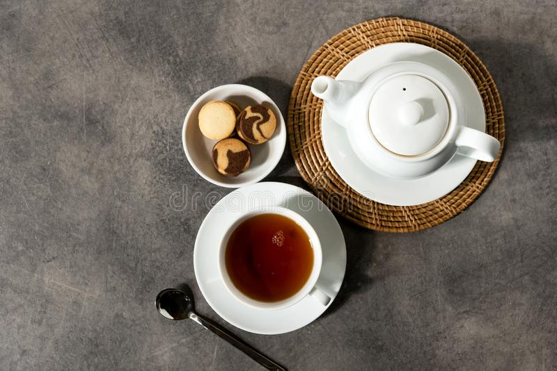 White porcelain tea cup and teapot, English tea on table, Afternoon Tea royalty free stock image