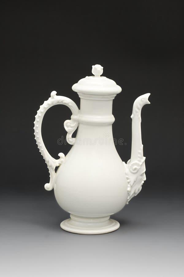 White porcelain teapot royalty free stock photography
