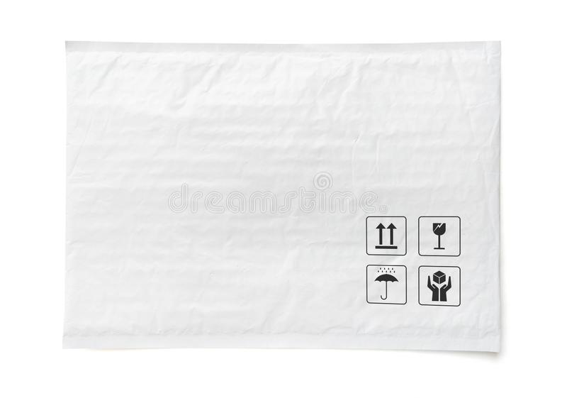 White postal package. Plastic parcel with fragile care sign and symbol. Object isolated on white background royalty free stock images