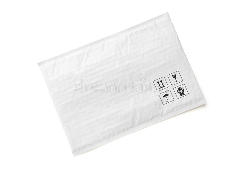 White postal package. Plastic parcel with fragile care sign and symbol. Object isolated on white background royalty free stock photos