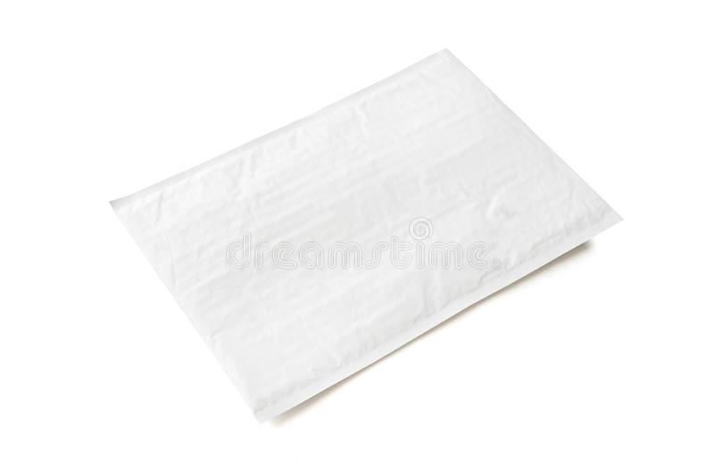 White postal package. Plastic parcel object background for online shopping advertising. Isolated on white background with clipping royalty free stock photo
