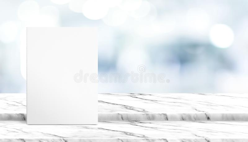 White poster on step white marble table top with blur patient waiting for doctor at hospital with bokeh light at background,Mock u. P template for display of royalty free stock photo