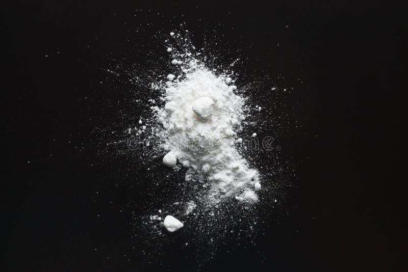 White powder. Abstract design of white powder on a dark background stock photo