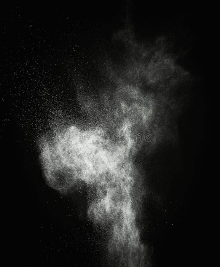 White powder exploding. Isolated on black stock images