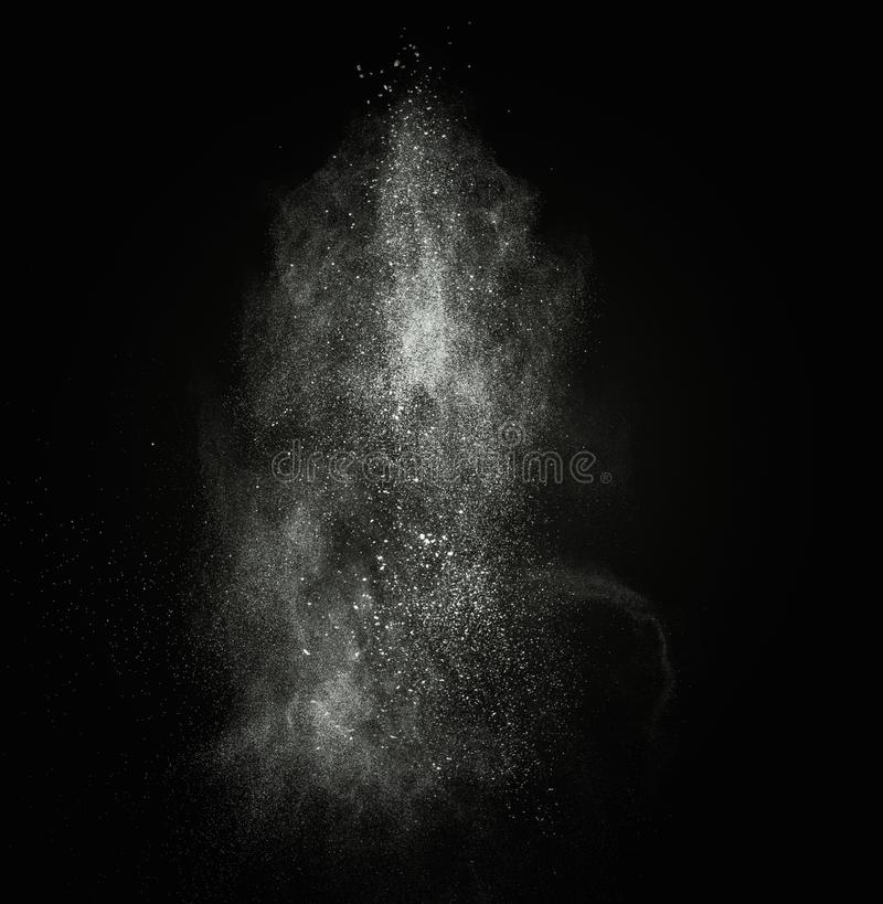 White powder exploding. Isolated on black royalty free stock photo