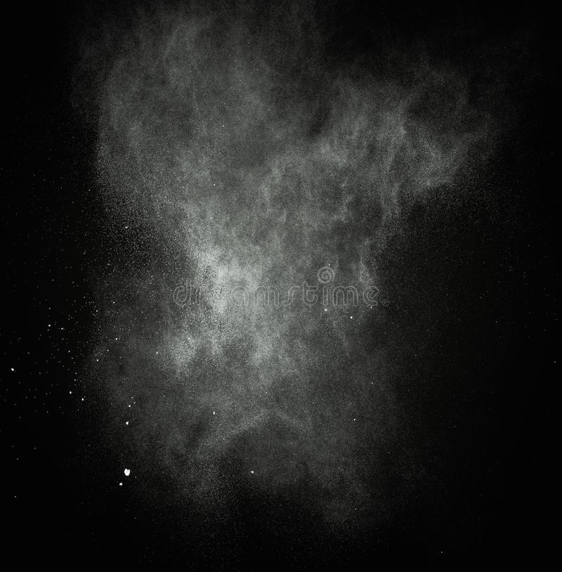 White powder exploding. Isolated on black stock images