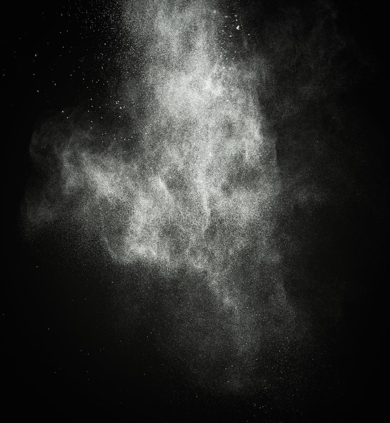 White powder exploding. Isolated on black stock photography