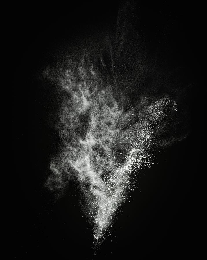 White powder explosion. White powder exploding isolated on black stock photo