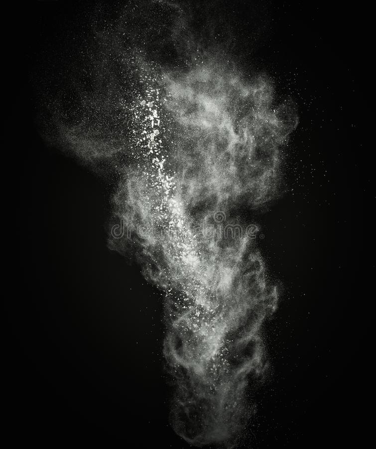 White powder explosion. White powder exploding isolated on black stock images