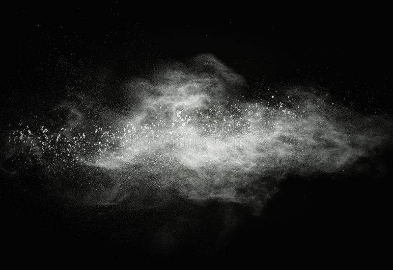 White powder explosion. White powder exploding isolated on black royalty free stock image