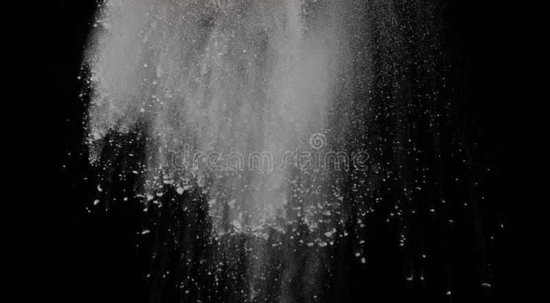 White powder explosion isolated on black background.  royalty free stock photos