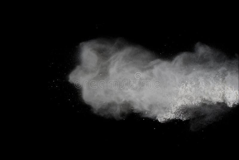 White powder explosion isolated on black background.  royalty free stock photo
