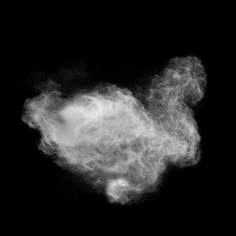 White powder explosion isolated on black royalty free stock images