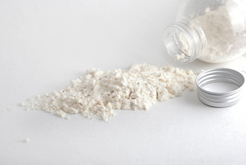 White powder from jar royalty free stock photo