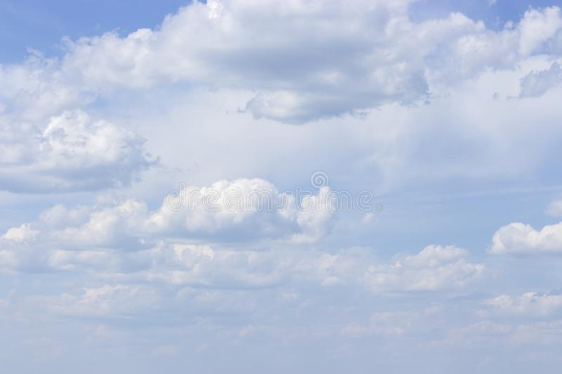 White powdery clouds on a clear blue sky, idyllic nature. Background wallpaper royalty free stock photo