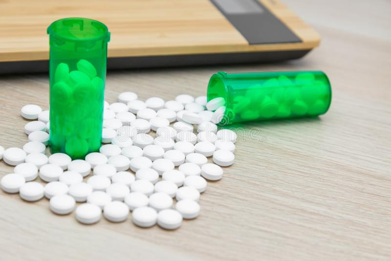 Pills and green bottles royalty free stock photography
