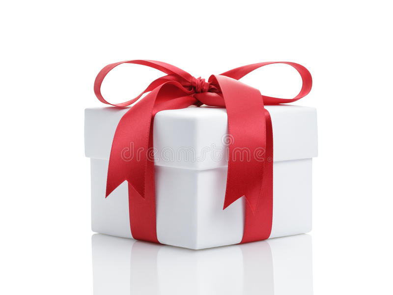 White present paper box with red ribbon bow royalty free stock images