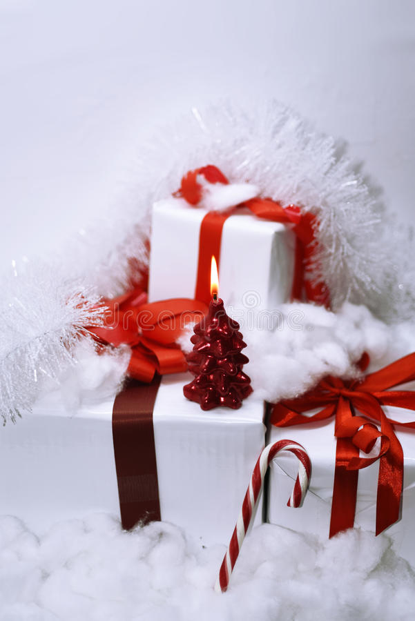 White presents with red ribbons. On white background royalty free stock images