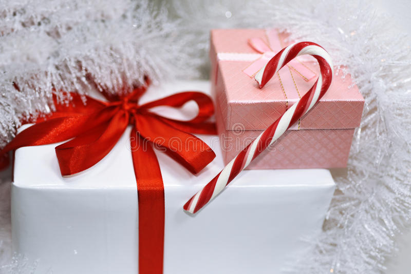 White presents with red ribbons. On white background royalty free stock photos