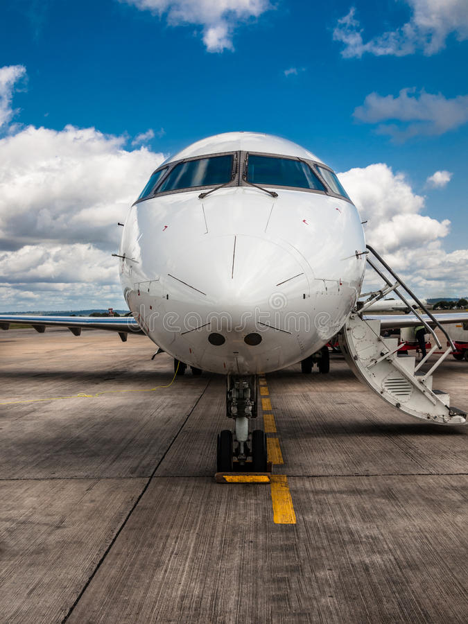 Free White Private Airplane Closeup With Folding Ladder Standing On The Aerodrome Field On A Background Of Blue Sky Royalty Free Stock Photo - 76481665