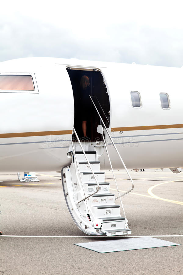 White private business jet and open ladder royalty free stock photography