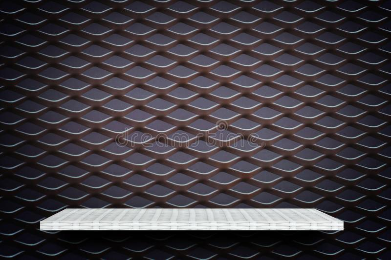White display shelf on metal grill background royalty free stock photography