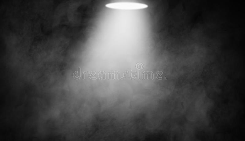 White projector. Spotlight stage with smoke on black background royalty free stock photo