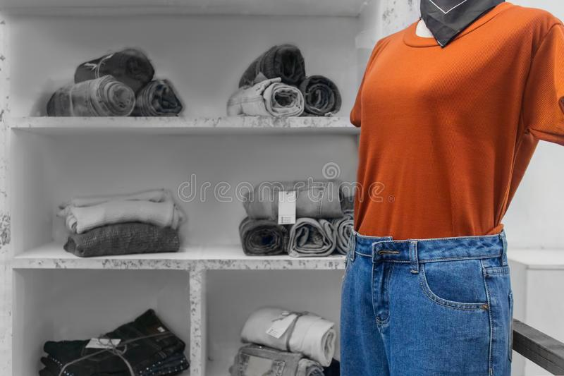 White Puppets model show fashion with orange shirt and women`s jean shorts in a fashion store royalty free stock photography