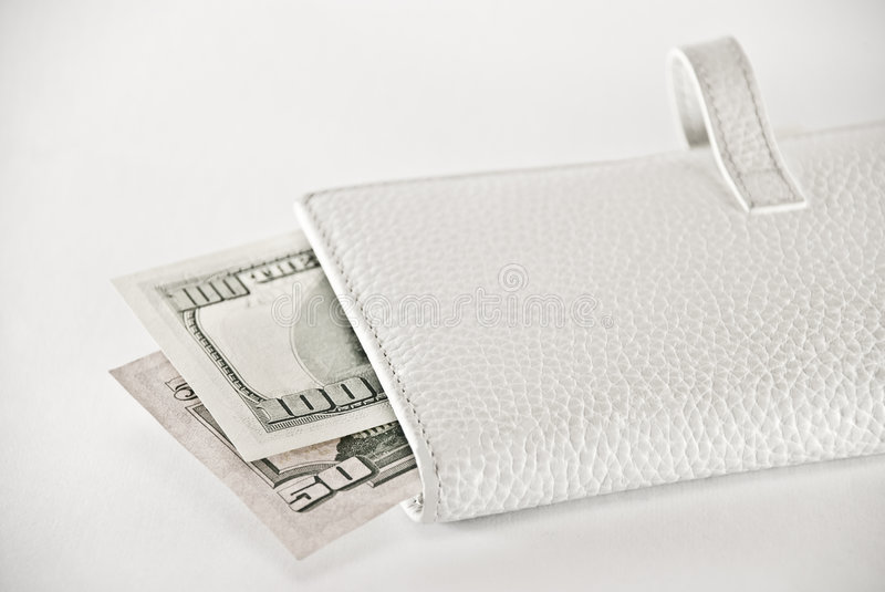 White purse with a money royalty free stock image