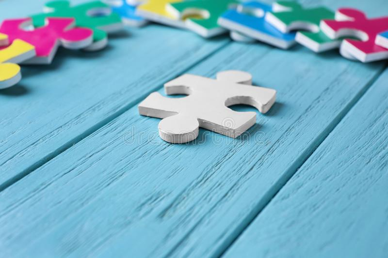 White puzzle on color wooden background royalty free stock image