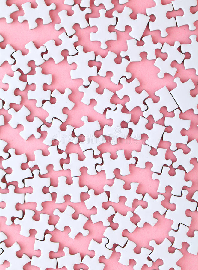 White puzzle on pink background stock images
