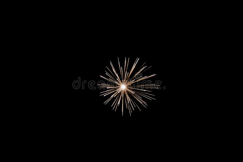 White pyrotechnic fireworks in the night. A single white pyrotechnic fireworks effect in the night in France stock images