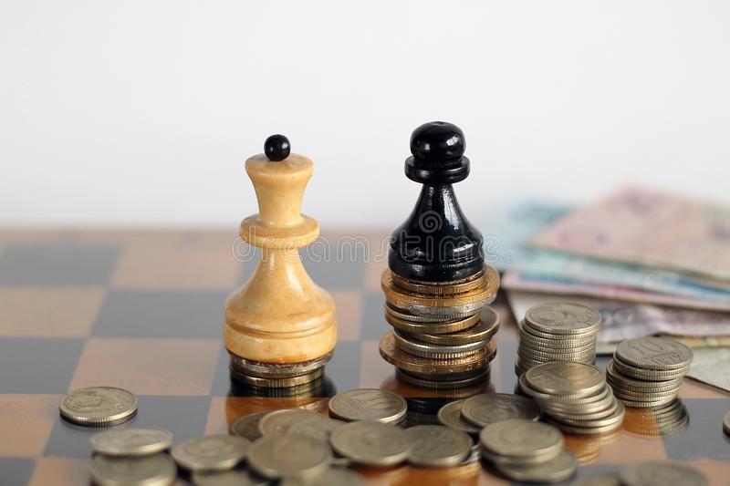 White queen and blake pawn with banknotes and cions. Finance, money, business, white chess, king, queen. World money with chess royalty free stock photography