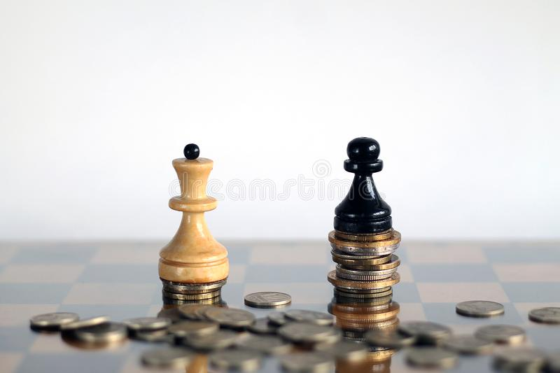 White queen and blake pawn with banknotes and cions. Finance, money, business, white chess, king, queen. World money with chess royalty free stock photo
