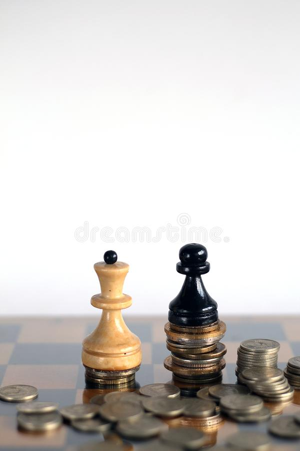 White queen and blake pawn with banknotes and cions. Finance, money, business, white chess, king, queen. World money with chess royalty free stock image