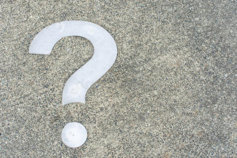 White Question mark on concrete concept - decisions, uncertainty, choice in life or business. Copy space.  royalty free stock image
