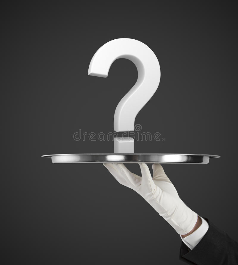 White question mark. Human hand holding silver plate with white question mark stock photo