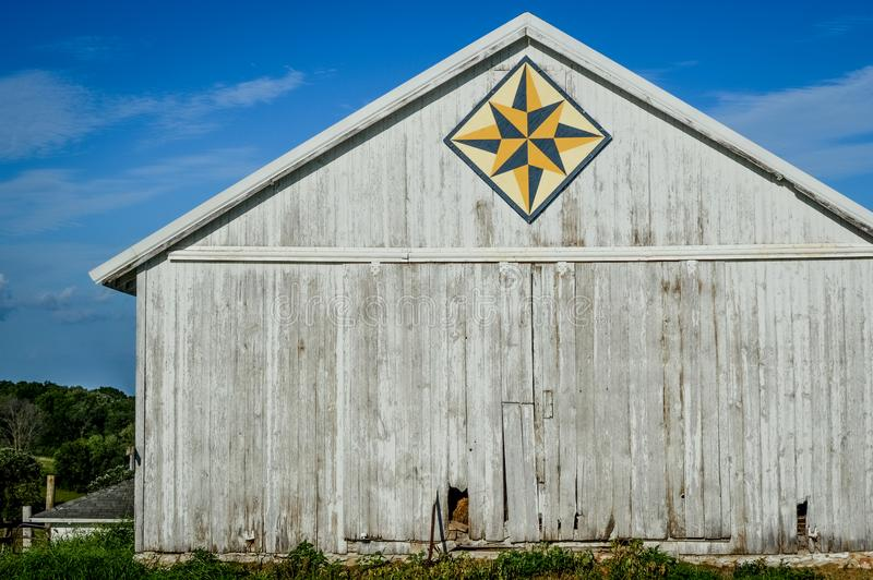 White Quilt Barn with Geometric Star Pattern royalty free stock images