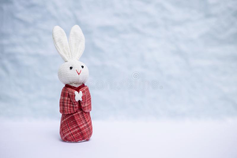 White rabbit in red traditional Japanese dress. Over blurred white background stock images
