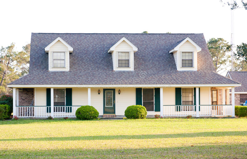 White Ranch Style American Home. White two-story American Victorian style home with green trim stock photography