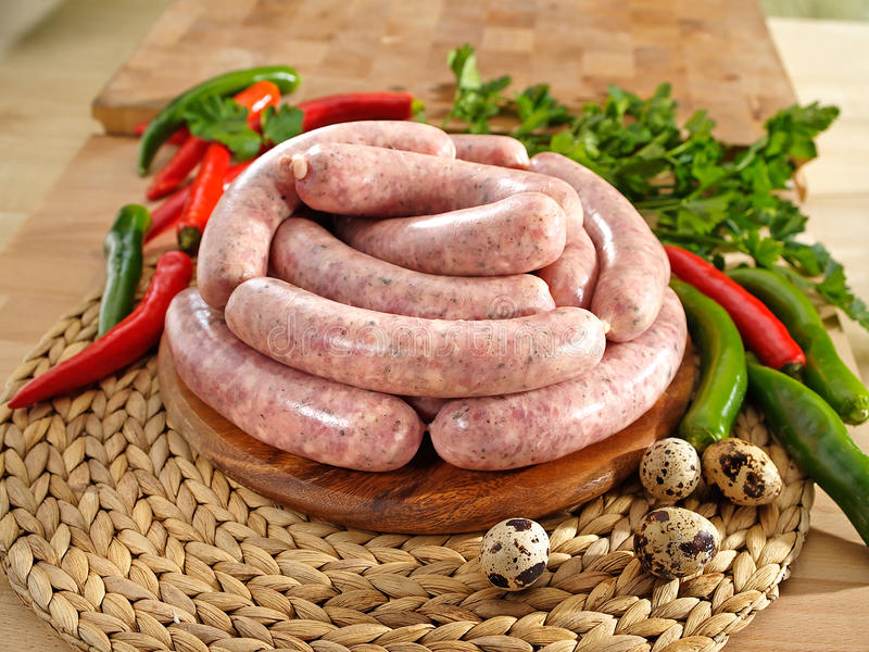 White Raw Sausage On A Cutting Board Stock Image