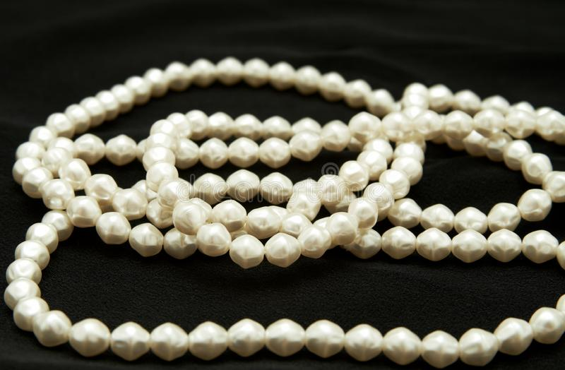 White real pearls on black background royalty free stock photos