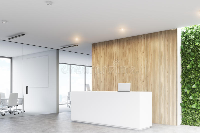 White reception, grass office, corner. Corner of a white reception desk with two laptops standing on it in front of a wooden office wall. There is a grass wall stock illustration