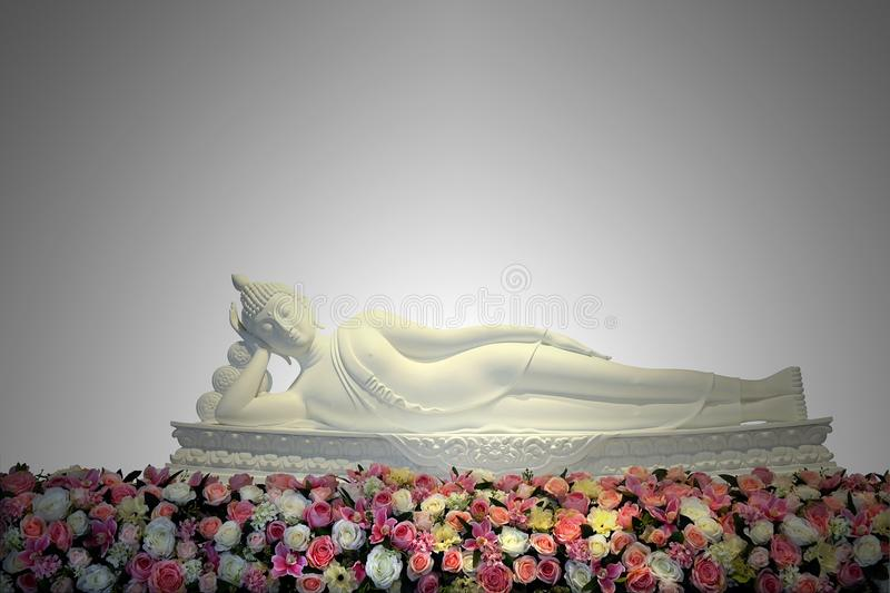 White reclining buddha statue with colorful flowers in main hall royalty free stock photo