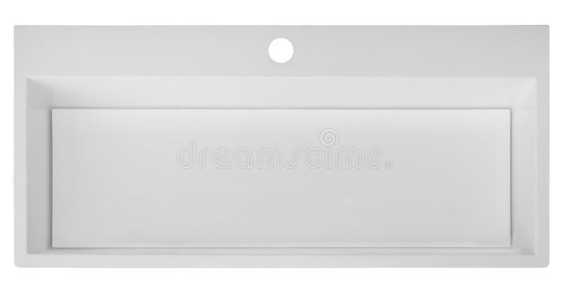 White rectangular modern washbasin without draining into the bat royalty free stock images