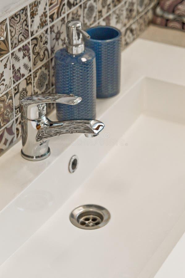 White rectangular sink detail with chrome tap royalty free stock photos