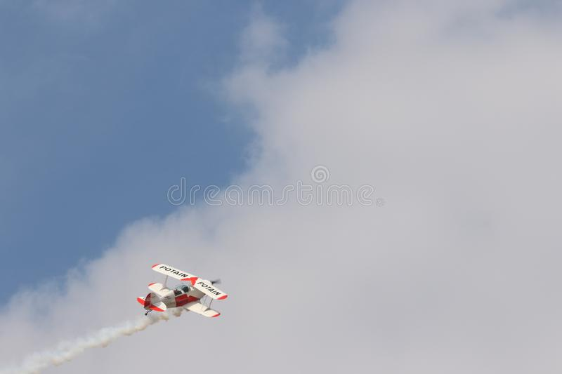 White and Red Biplane Flying during White Cloudy Day royalty free stock photo